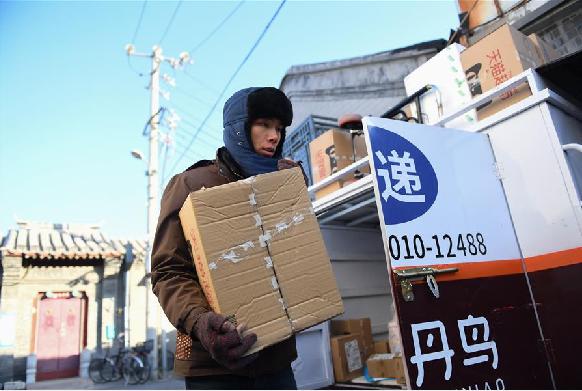 寒冬裏穿梭在北京城的快遞小哥